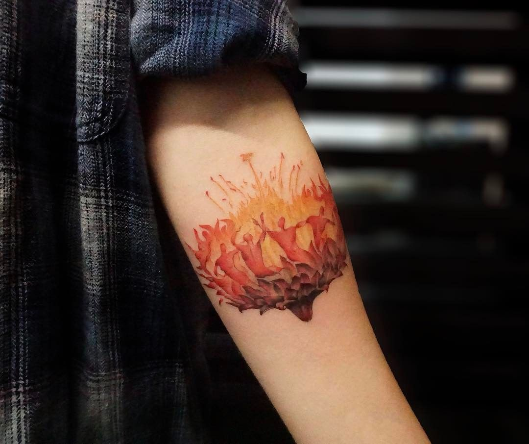 Fire Flower Dance Tattoo Idea On The Forearm Tattoo Ideas Fire