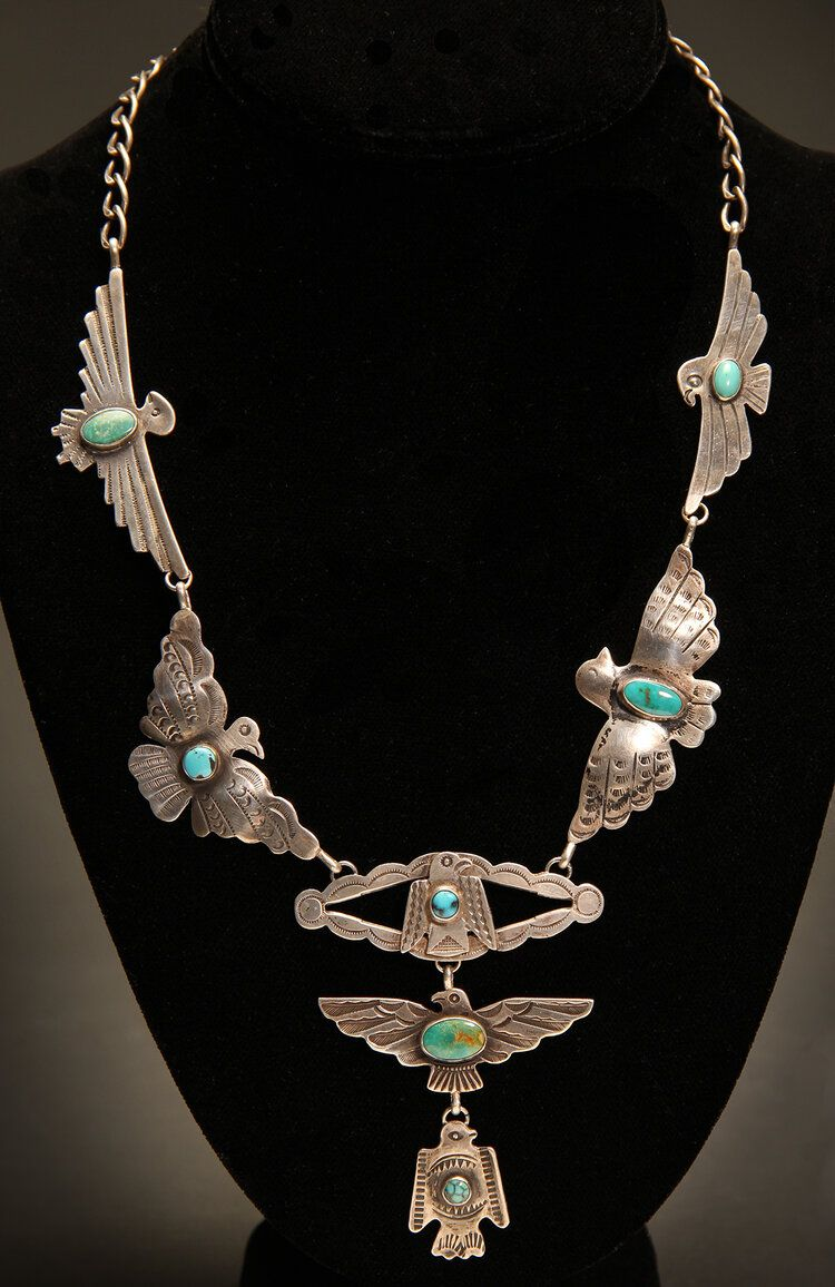 Distinctive pendant of shell and coral set in sterling silver is featured in this handmade necklace
