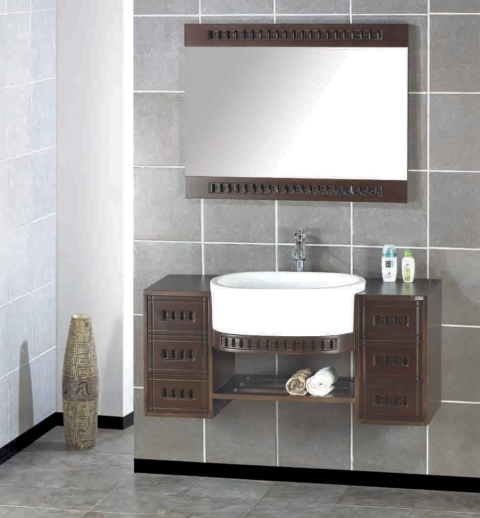 Artistic wooden bathroom cabinets feats white sink and mirror on gray wall tile plus brown - Ikea bathroom tiles ...