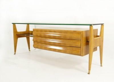 Sideboard, Italy, c. 1940s. Maple chest of three drawers with parqueterie surfaces; maple shelves with glass tops to the right and left, a crystal glass top above; maple leg construction with brass fittings and sabots.