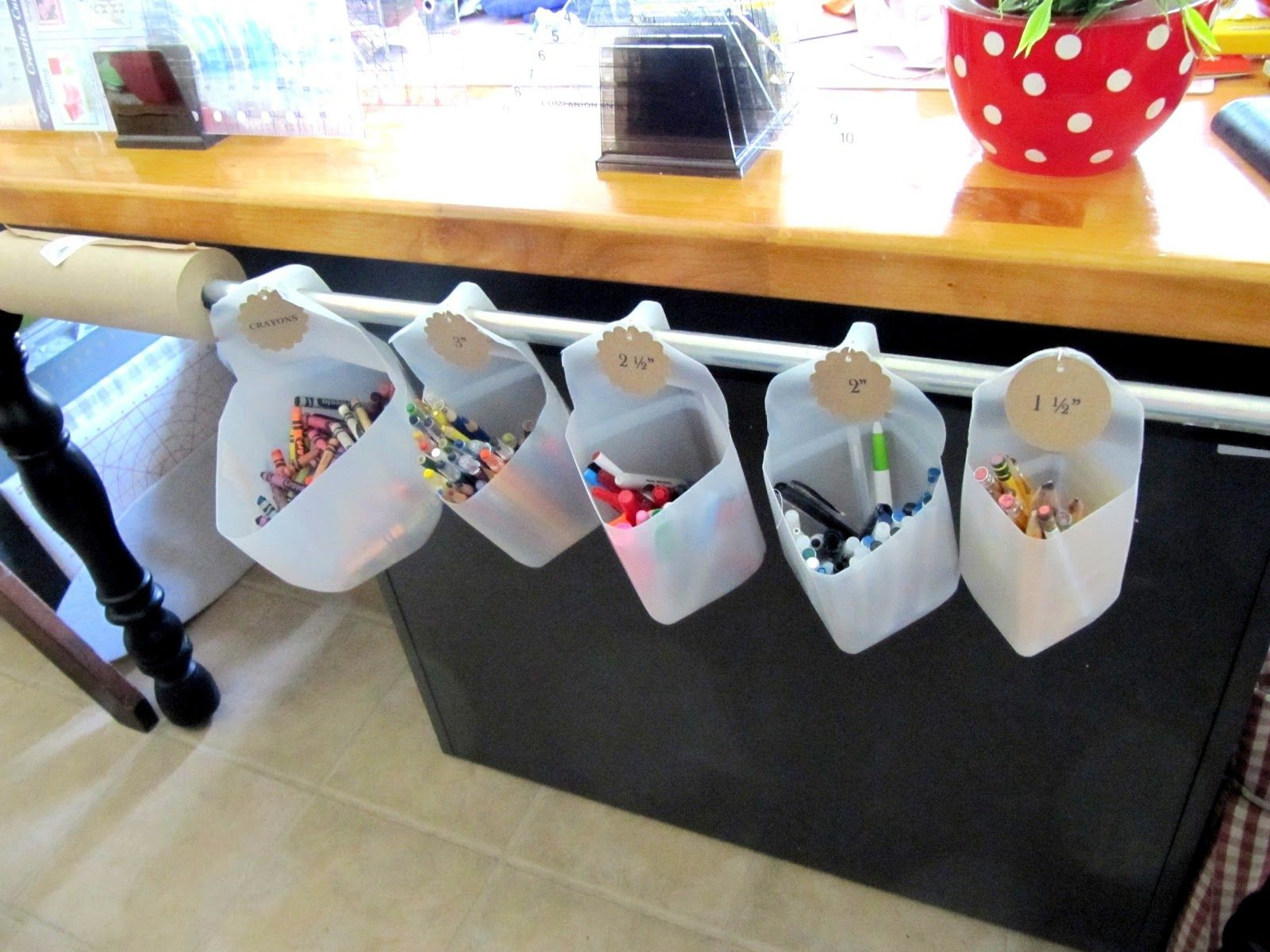 Sew Many Ways...: organizing with milk jugs and a length of pipe.