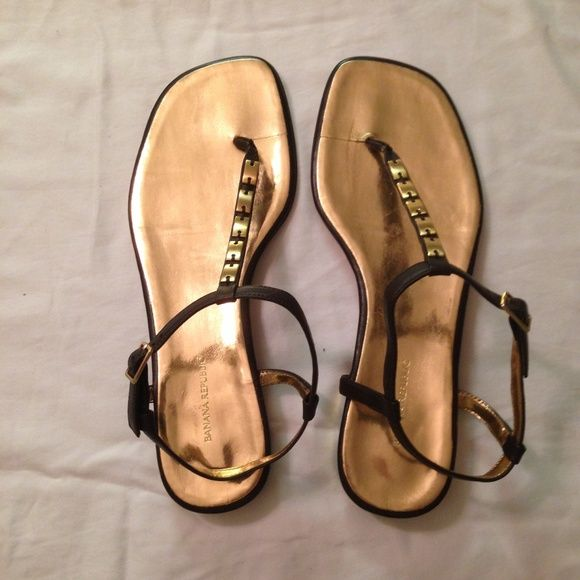 NWOT Banana Republic Gold Thong Sandals Size 8.5, I think they run a little narrow so I can provide measurements if needed (the ankle strap seems a little short).  Brown leather with gold footbed and details - the 2nd picture is with a flash to see the marks on the bed of the foot.  You can't seem any of them when wearing but are visible & priced accordingly (marks just from being packed away).  The gold also looks a little bronzey vs true gold. Banana Republic Shoes Sandals