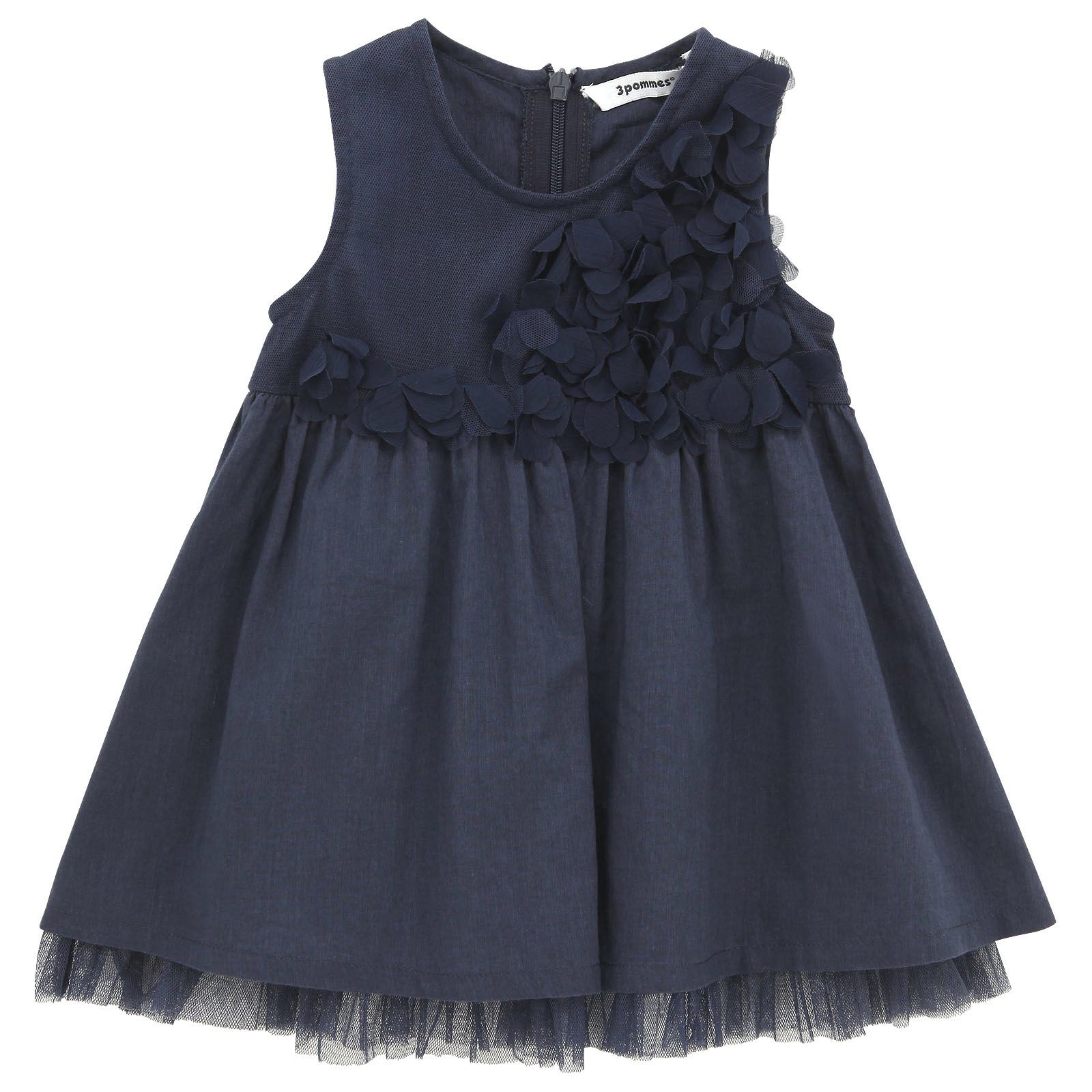Sleeveless navy blue dress made of tulle and percale. Round neckline. Zip fastening at the back. Appliqué flower petals on the chest.