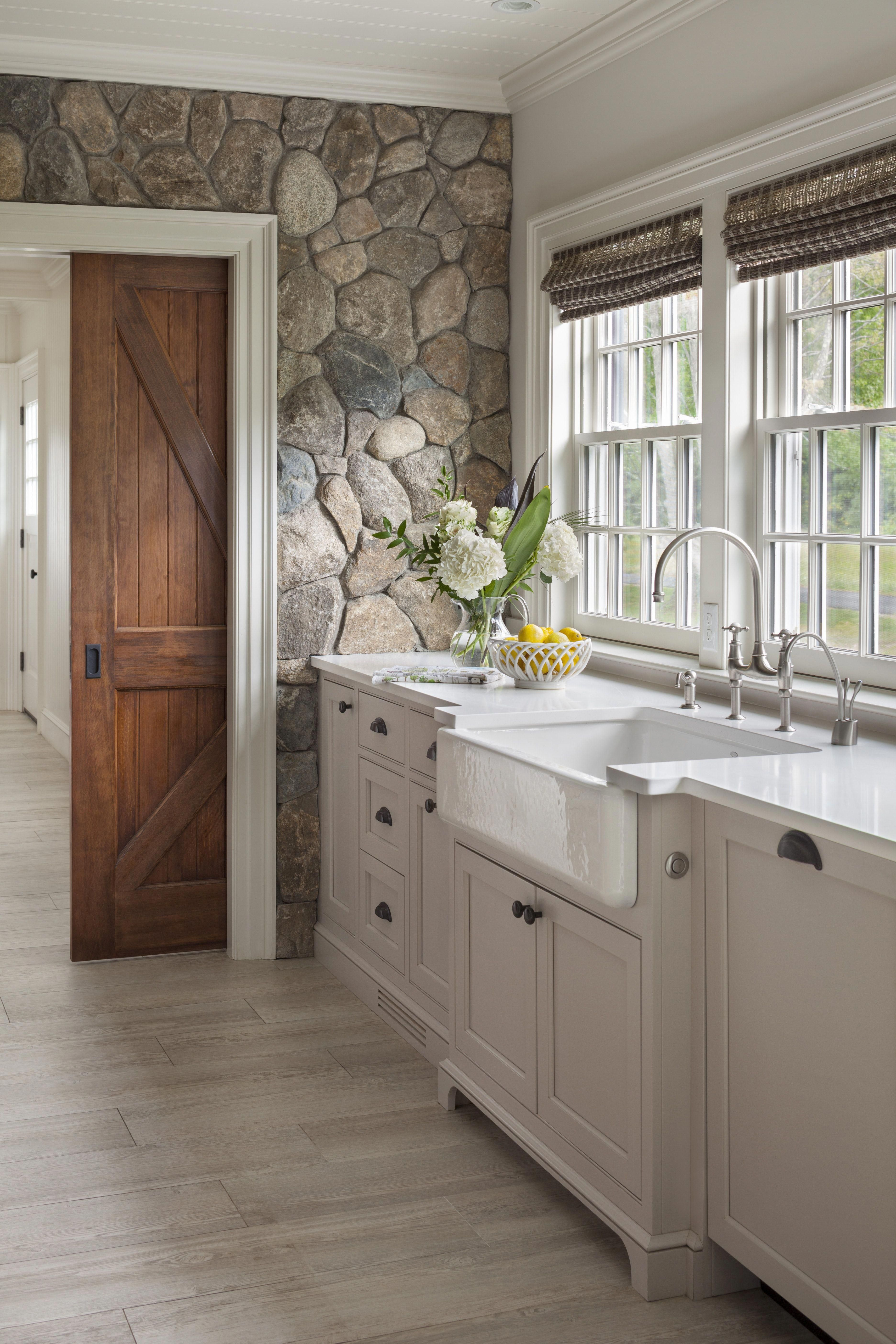 Farmhouse Kitchen With New England Fieldstone Accent Wall And Sliding Barn Door Farmhousekitchen Rustic House Kitchen Remodel Home Kitchens