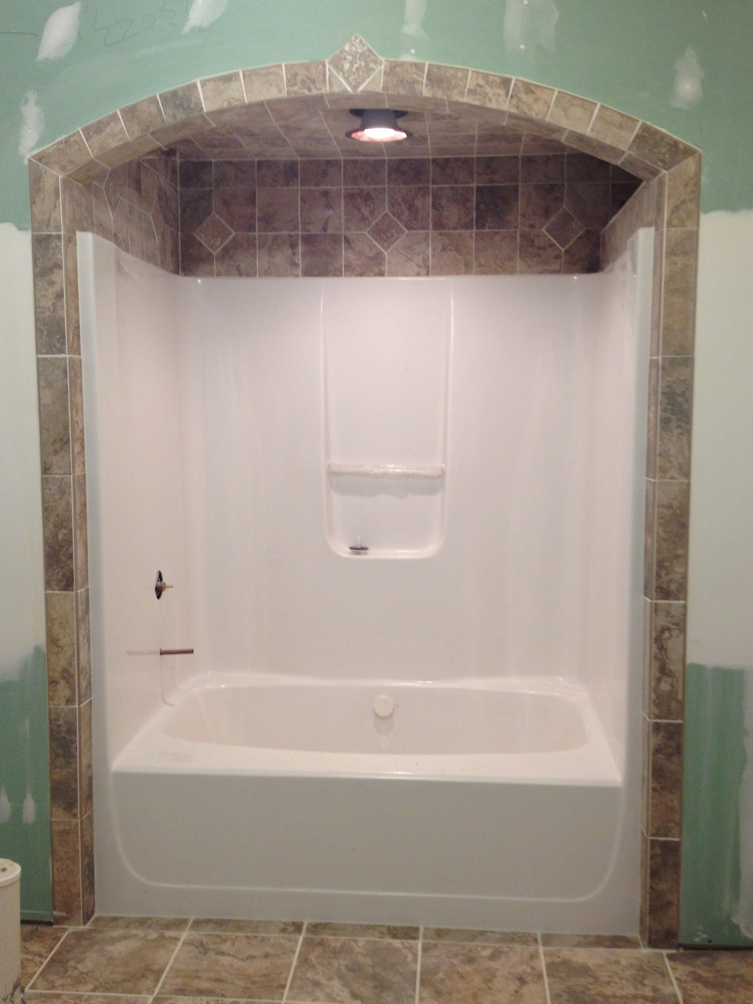 Bathtub tile... Like the idea of tile around and above shower/tub ...