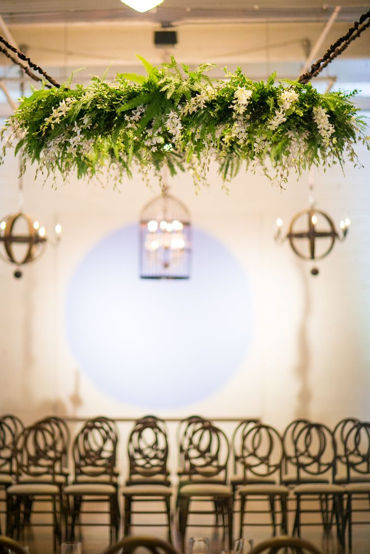 Greenery and white flower chandelier larissa cleveland wedding planners malvernweather Choice Image