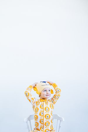 Arlo in the cutest lion pajamas · Minneapolis children's photography in a modern, natural light studio · ©sara montour