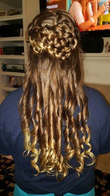 Braided bun and curls half up hair style