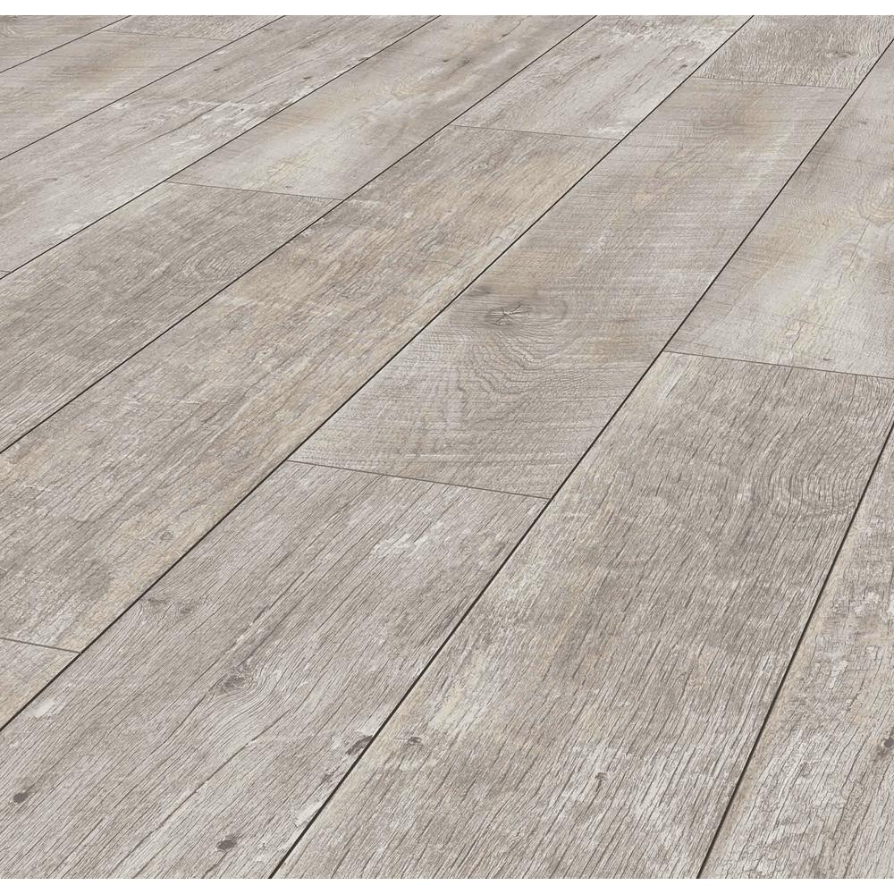 Folkstone Oak S Texturing And Cool Rustic Grey Coloration Achieve The Look Of Real Hardwood Adding Beauty Oak Laminate Flooring Laminate Flooring Oak Laminate