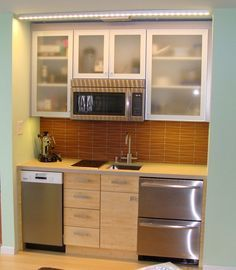 mini kitchen. smart idea to put the microwave up and cupboards
