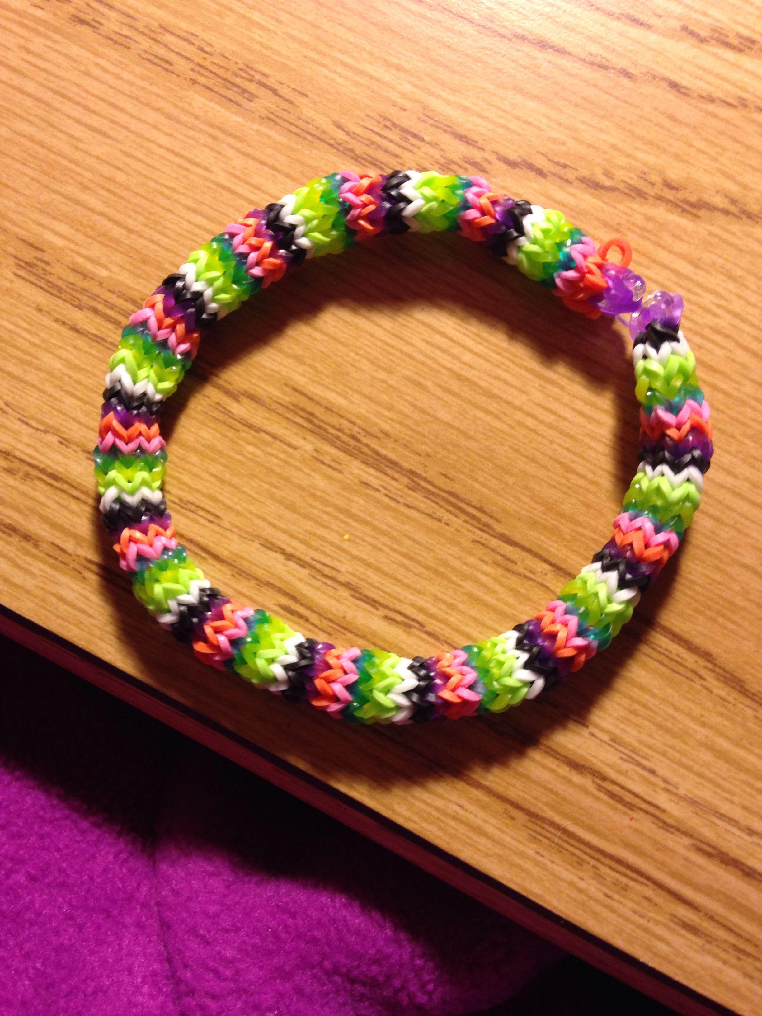 Multicolored hexafish rainbow loom bracelet.