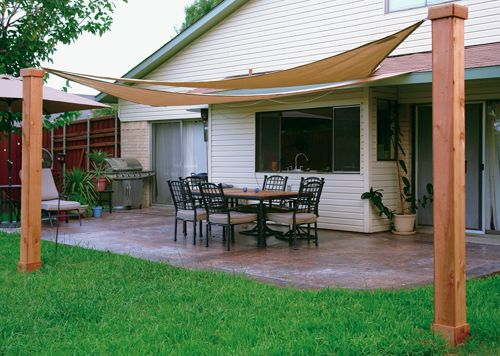 Made In The Shade Custom Stamped Concrete Patio With Sails To Provide Protection From