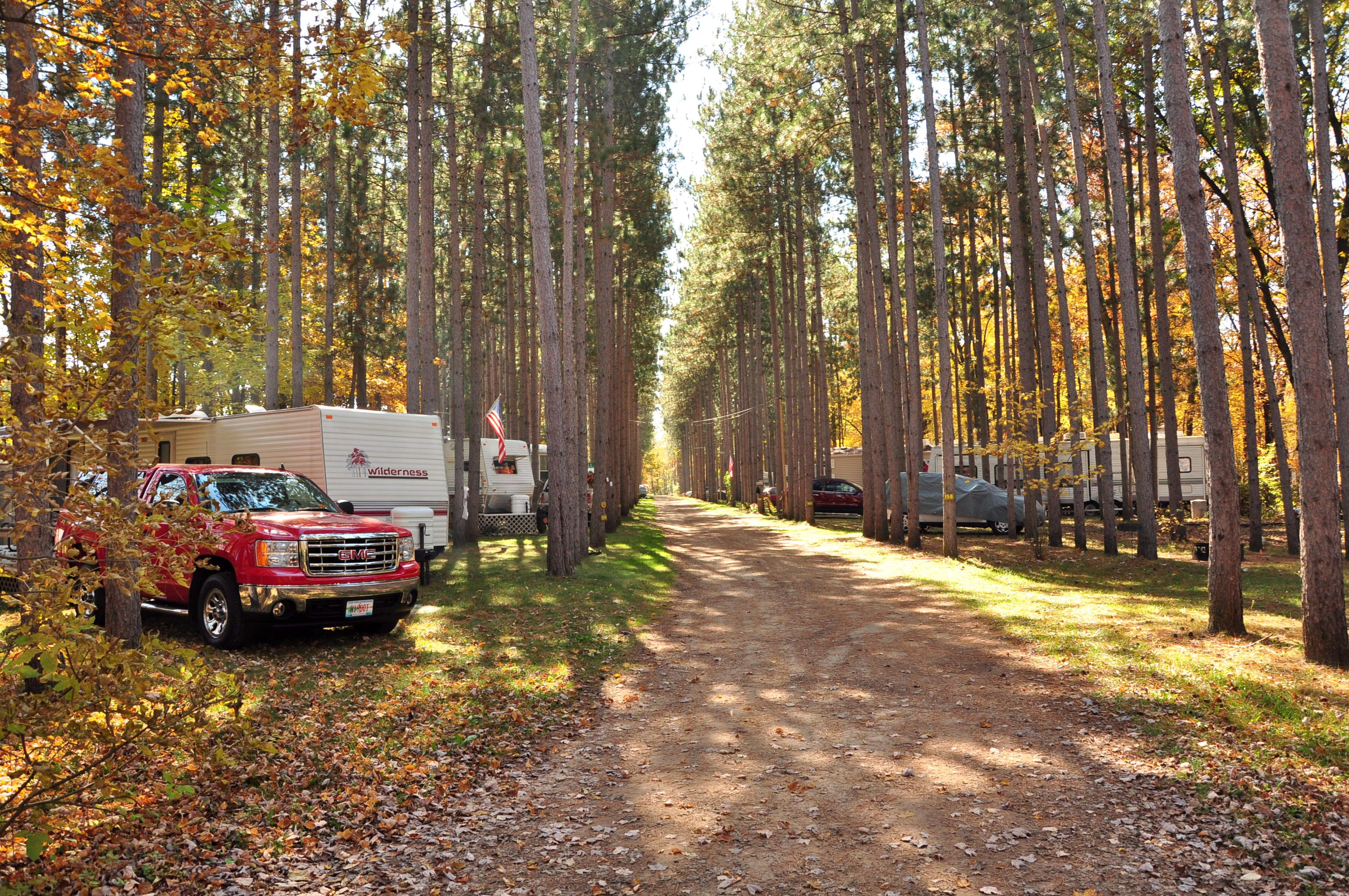 We Love When The Sun Peaks Out Between The Trees Yukon Trails Wi 100daysofcamping Camping Resort Resorts In Wisconsin Yukon Trail