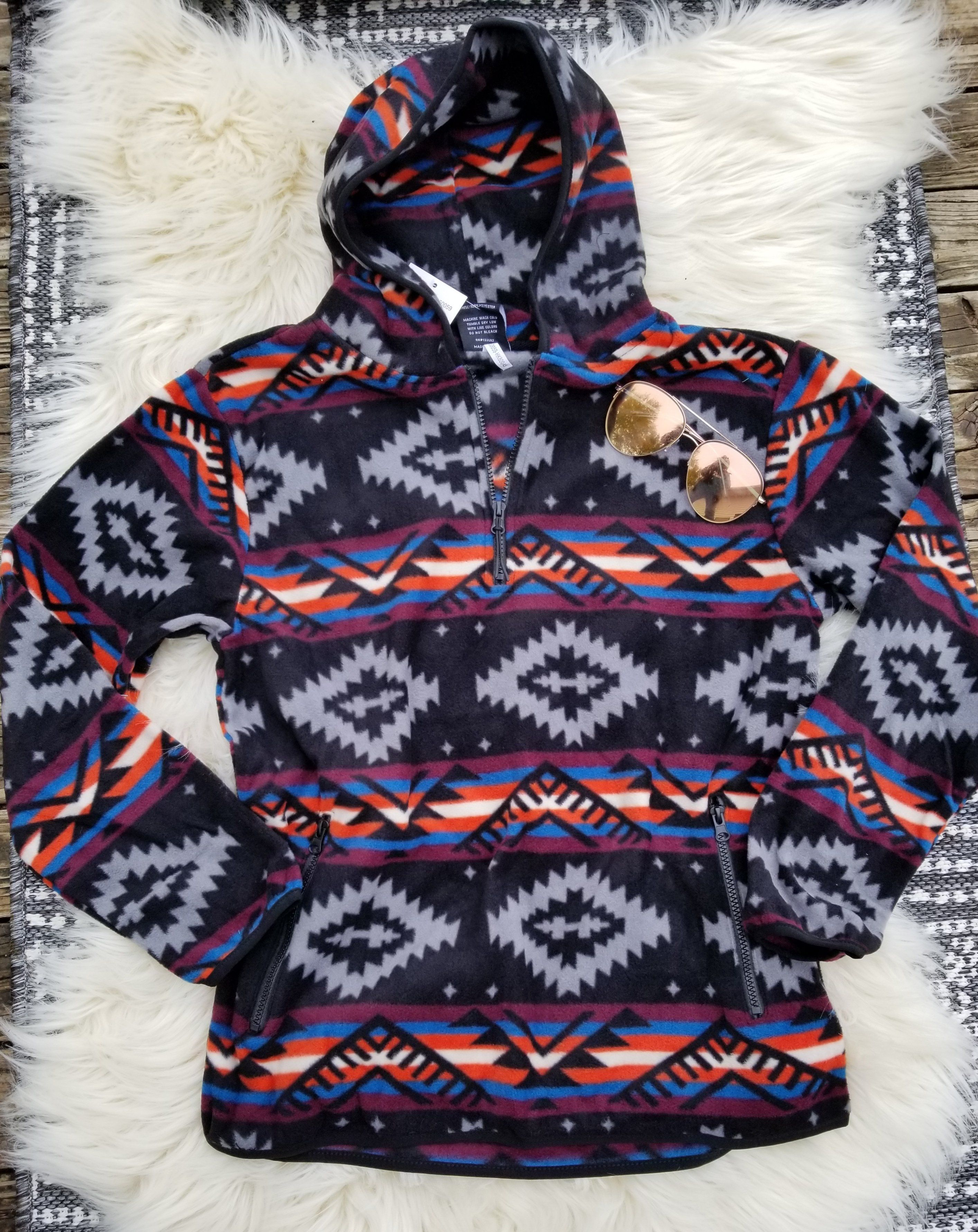 """Vibrant southwestern fleece hoodie Zipper at neck and zippered front pockets Unisex fit - for gals and gals 100% polyester Small 42"""" chest Medium 46"""" chest Large 50"""" chest XL 52"""" chest"""