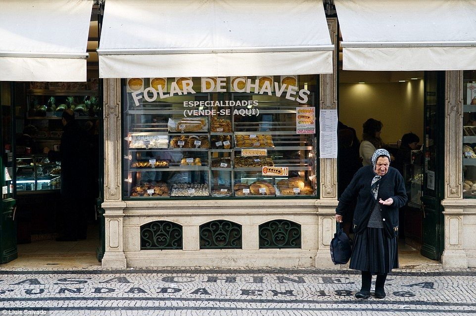 Lluis Salvado photographed an elderly woman leaving a bakery in Lisbon. The photo won the ...