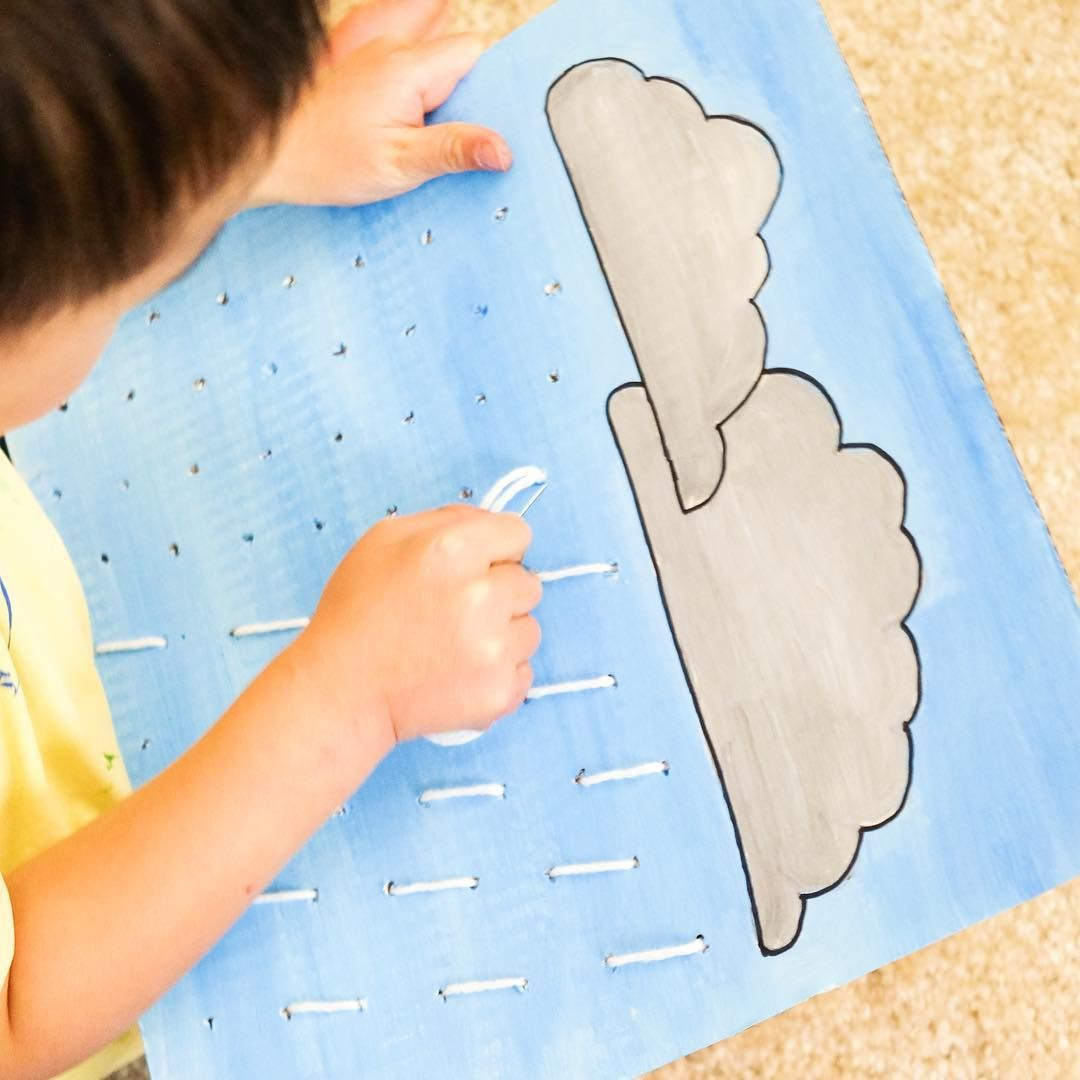 RAINDROPS SEWING BOARD  A cute activity to introduce sewing to my boy.  I twisted a paper clip into a 'needle' and