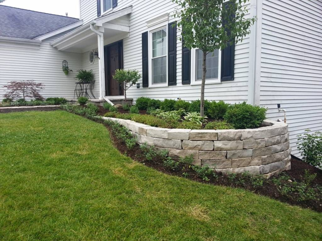 White Stone Front House With Stone Retaining Wall Natural Sto Landscape Ideas Front Yard Curb Appeal Landscaping Retaining Walls Small Front Yard Landscaping