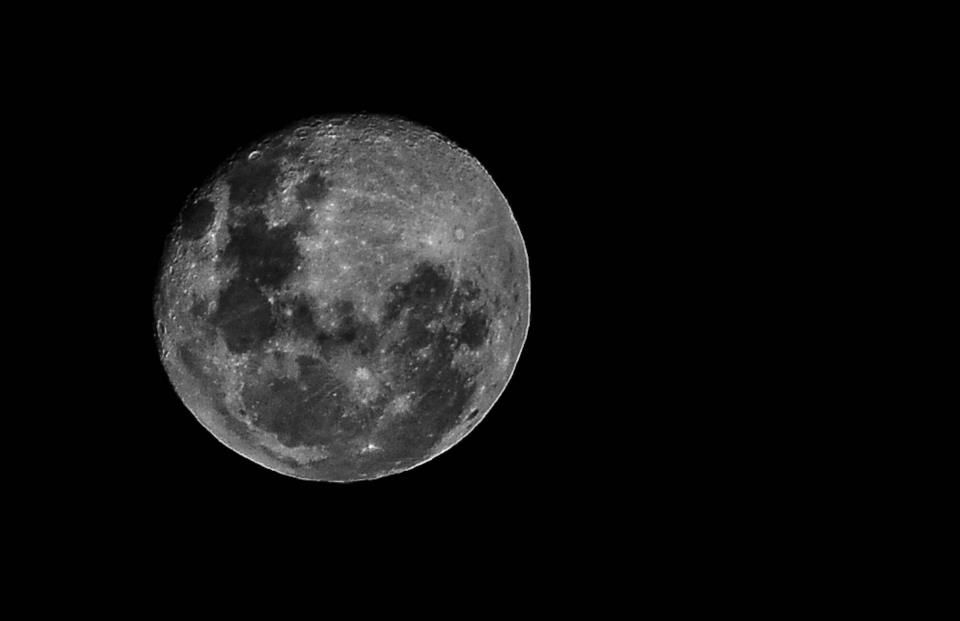 I know this is old news now, but I was fitting a new filter to my 80-200mm lens and took this shot of the moon a few minutes ago - hand-held, no tripod, no vibration reduction/image stabilisation. I quite like how it came out...