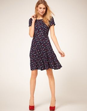 Parrot print tea dress - so cute!  With the red shoes - gorgeous!