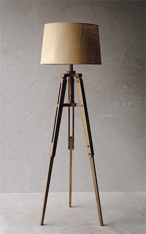DETAILS Cast A Warm Glow In Your Reading Nook Or Library With This Tripod Floor Lamp Featuring Mariner Wood Finish And Linen Shade