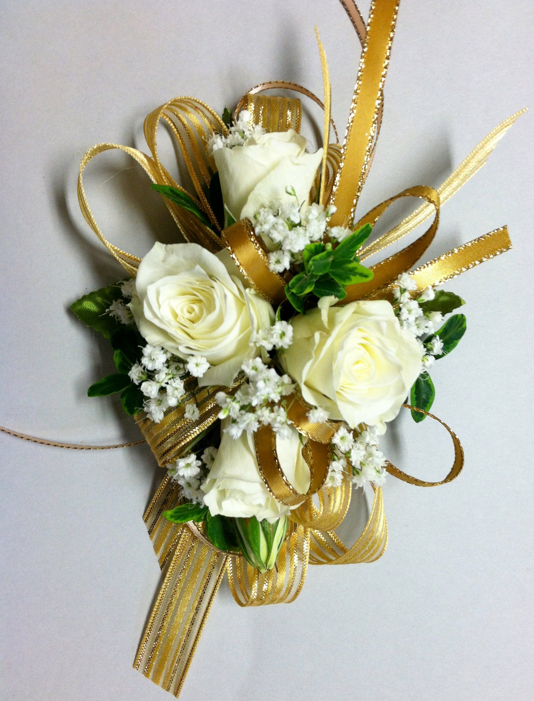 Gold Ribbons Accent A Mix Of Creamy White Spray Roses And Babies