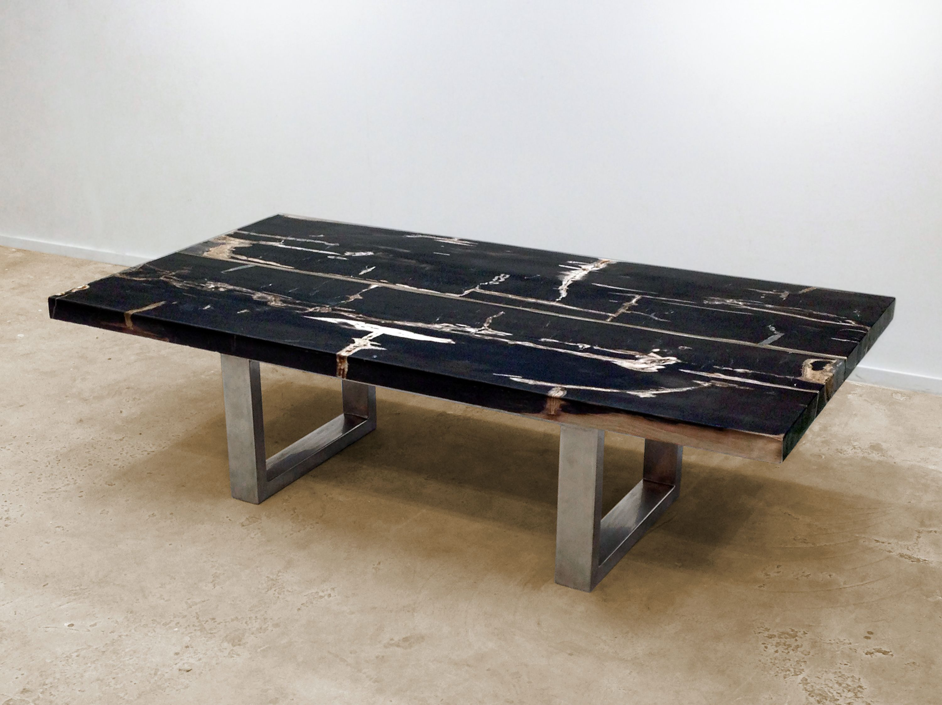 David Alan Collection Petrified wood coffee table with stainless
