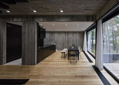Timber Clad Seaside House With Wood Textured Concrete Interior By Ultra  Architects The Concrete Walls Inside This House In Poland By Ultra  Architects