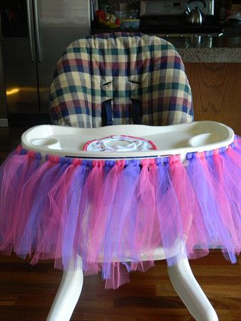 I decorated the high chair with a pink and purple tutu ...