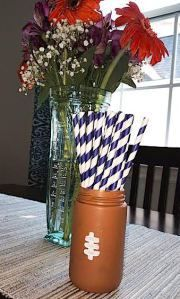 Paint jars to look like footballs, and add some fun to your tailgate!