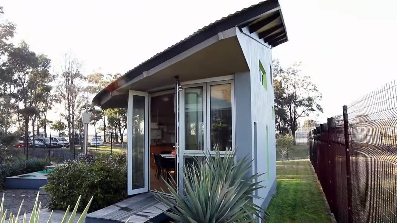 This is a modern tiny cabin and a twostory popup tiny house The