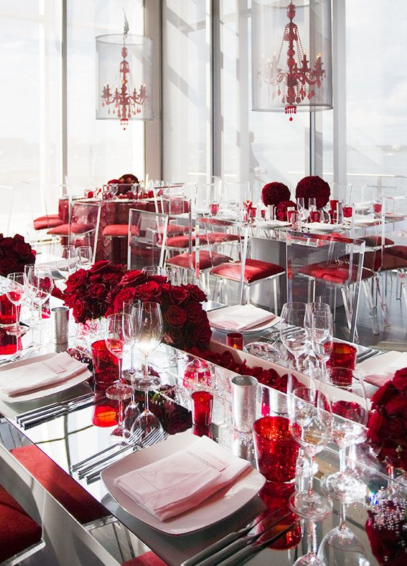 Ruby Red Chandeliers Lit Up The Room From Above Turning The Space