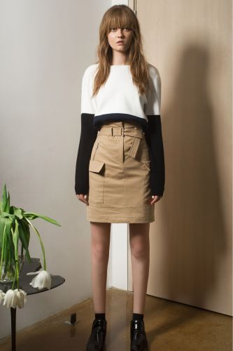 black + white sweater with mini pencil skirt.
