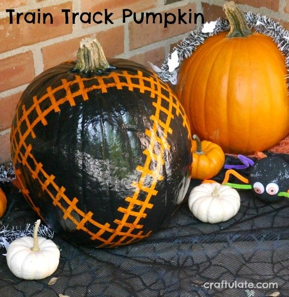 Little train lovers will adore this pumpkin decorated with a train - halloween pumpkin painting ideas