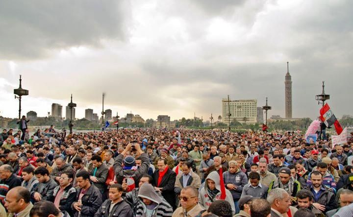 Ppl  in the Qasr el Nil bridge .. entrance of the Tahrir square .. prayers of the maghreb and the humanness of islam .. the feeling of being connected to god .. all of us at the same time and the same place .. all are the same .. ready .