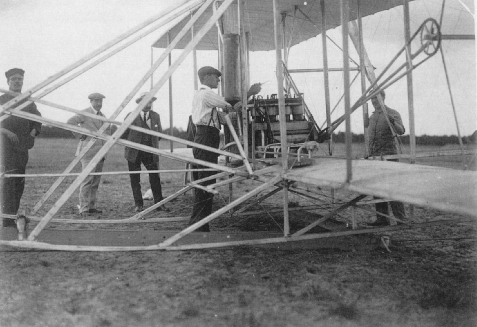 First Wright Brothers Flight for wilbur wright adjusts the engine of his aircraft, france 1908