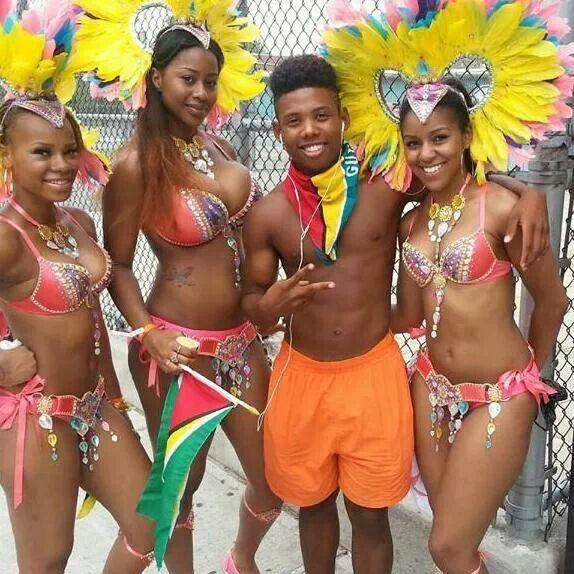 Guyanese teens in extravagant costumes celebrating carnival