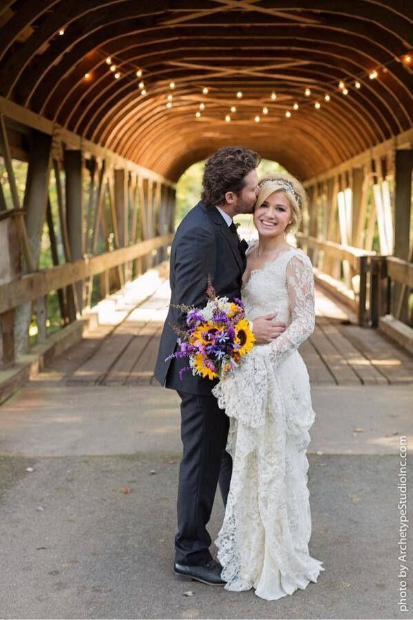 beautiful dress, flowers and looooove the bridge!