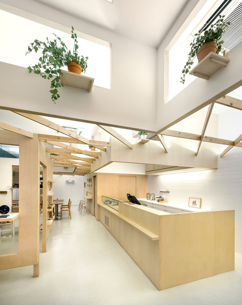 Produce Intersects Two Retail Spaces With Plywood Planes In