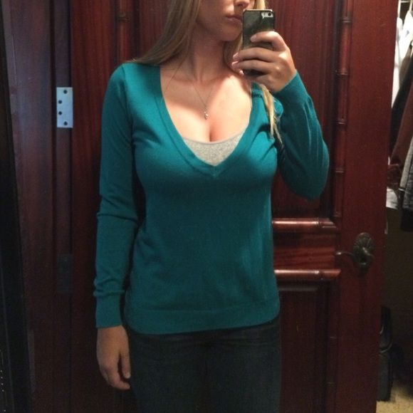 Longsleeve blue sweater shirt Really comfortable deep V sweater top. Looks good with a cami underneath or a bralette Forever 21 Sweaters V-Necks