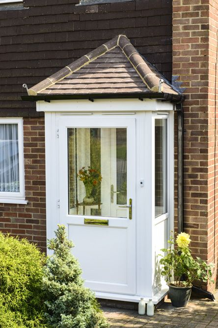 white upvc front door and porch small town porches