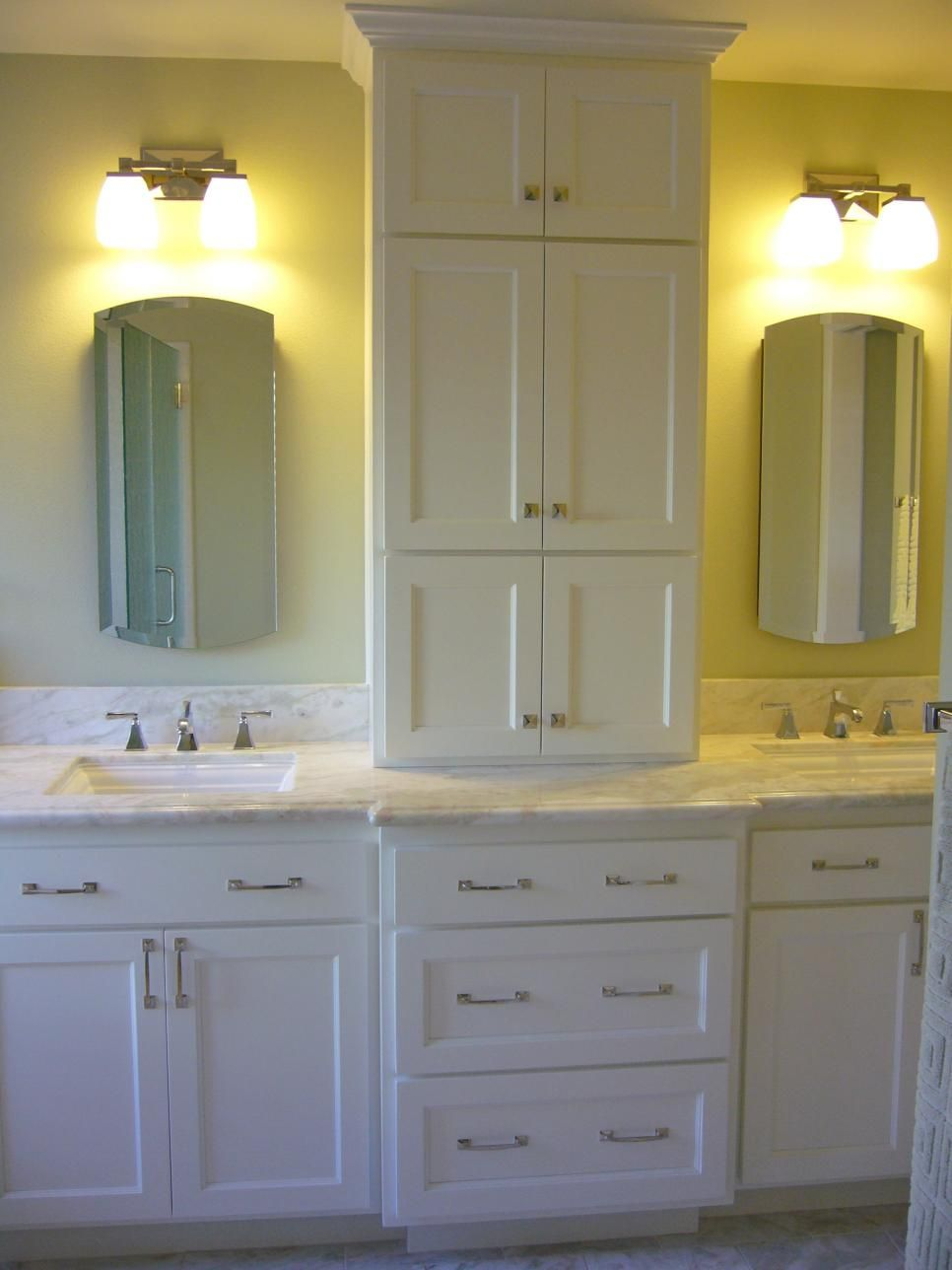Pics Of A tall custom tower between the double sinks provides easily accessible storage for often