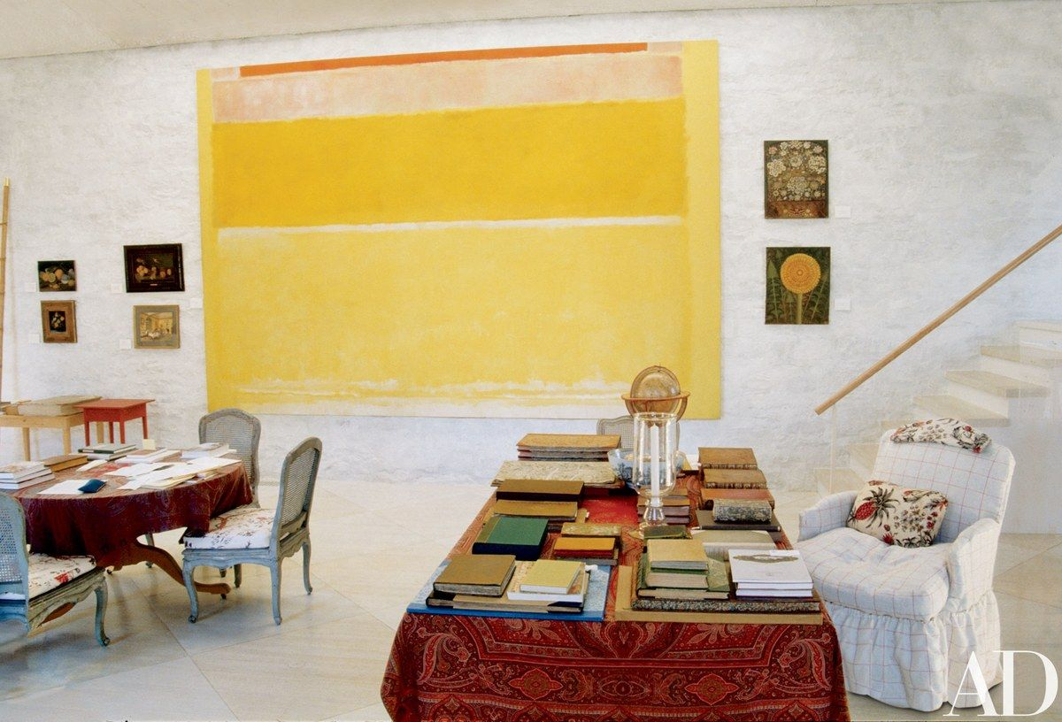 In the library, a 1954 Mark Rothko work glows against a wall of ...