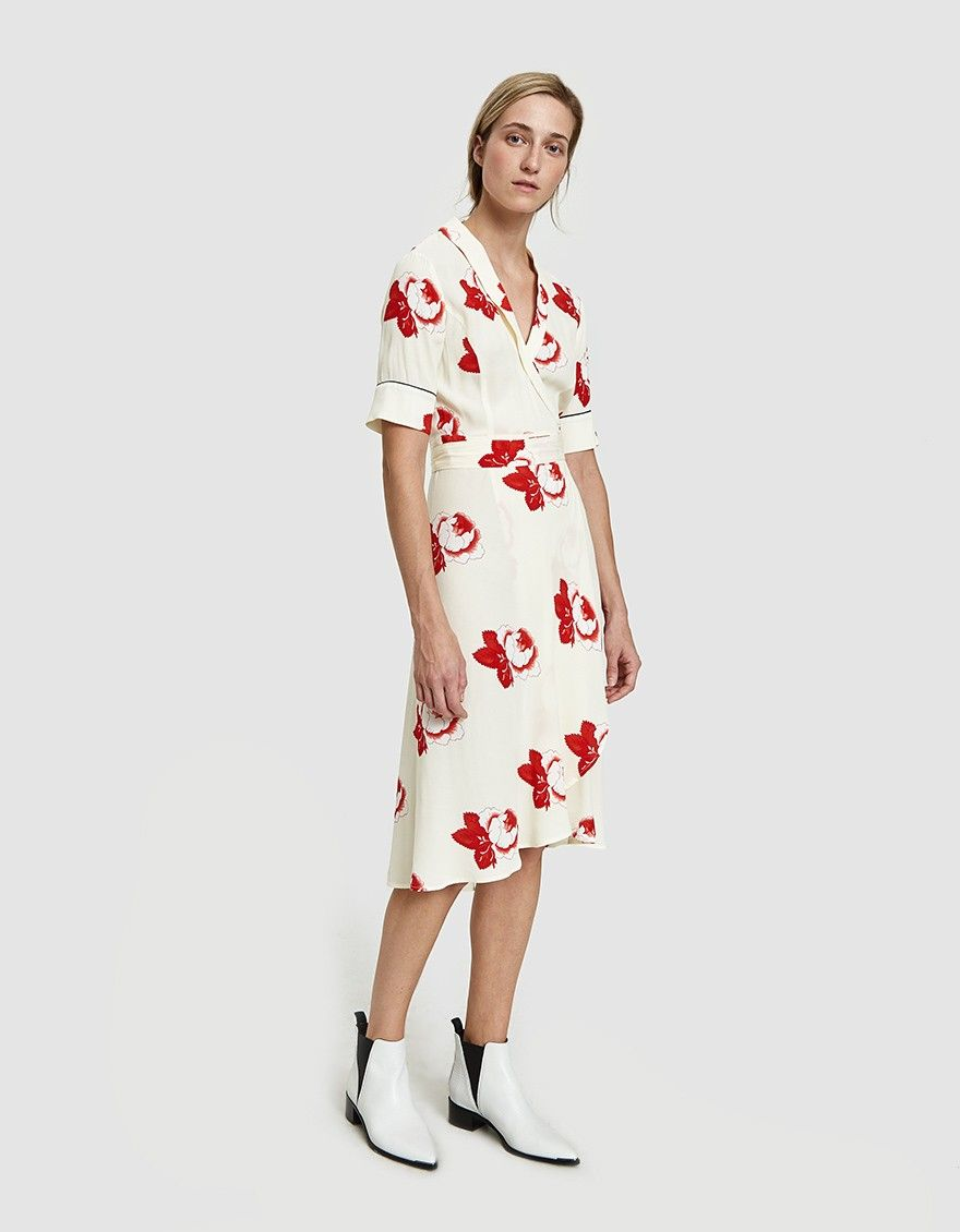 c9ad195b Wrap dress from Ganni in Vanilla Ice. Allover floral print. Deep-V neckline  with shawl collar. Short sleeves. Wrap-ront closure with self-tie belt at  waist.