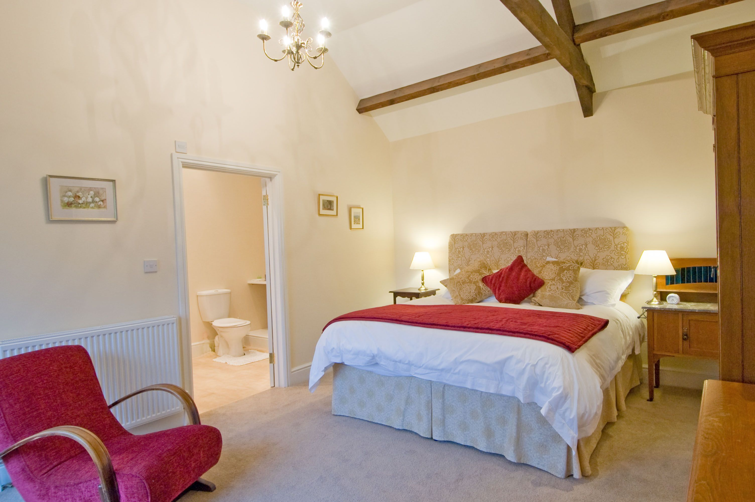 Sheep Pen Cottage master bedroom king sized bed with bathroom ensuite