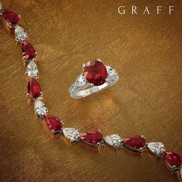 Beautiful red A ruby and diamond line bracelet set with 27 perfect pear shape stones sits alongside a perfect 4.06ct ruby ring, both pieces showcasing the ideal 'pigeon blood' colour within an elegant and sophisticated design. #GraffDiamonds #Ruby #RubyRing #FineJewellery #Diamonds