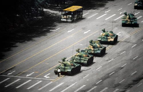 Tiananmen Square 1989...a student who tries to stop the tanks by standing in front of them.  He lived but many others did not and died in the square that day.