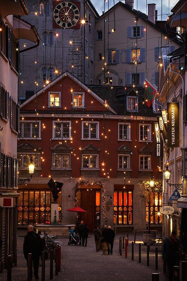 Photo of An alley in the old town of Zurich at night with Christmas lights, Switzerland. …