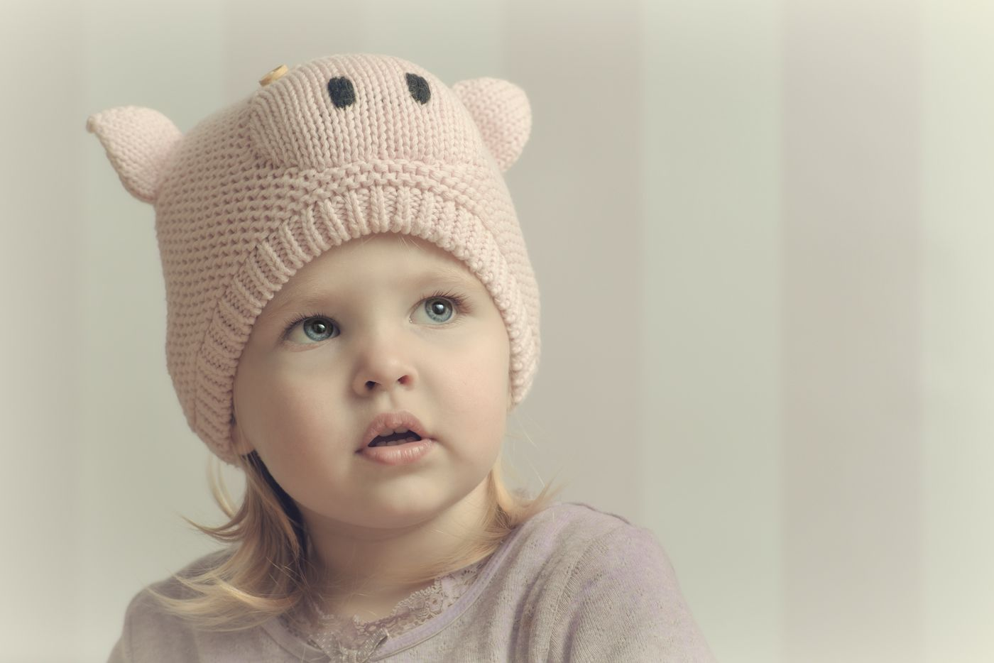 "Sent to us by Aaron Karnovski  who writes ""This Little Piggy"" taken yesterday, was a spur of the moment shot of my 21 month old niece, Amelia. She looked so adorable wearing the little hat that I simply had to photograph her. I quickly set up an off camera manual flash and shoot through umbrella, as my sister read Amelia a story. I waited for her to become totally engrossed before taking the shot. Photograph taken at home using a Nikon D800 and an old 70-210 f/4-5.6D @210mm f/8."