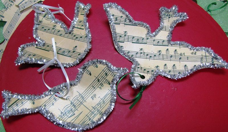 Music Sheet Silver lined Paper Bird Ornament. $4.50, via Etsy.