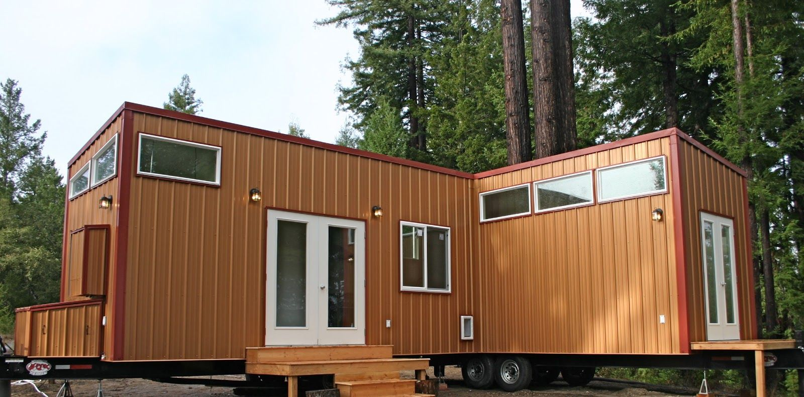 Two Tiny Houses On Wheels Permanently Joined Together To Make A